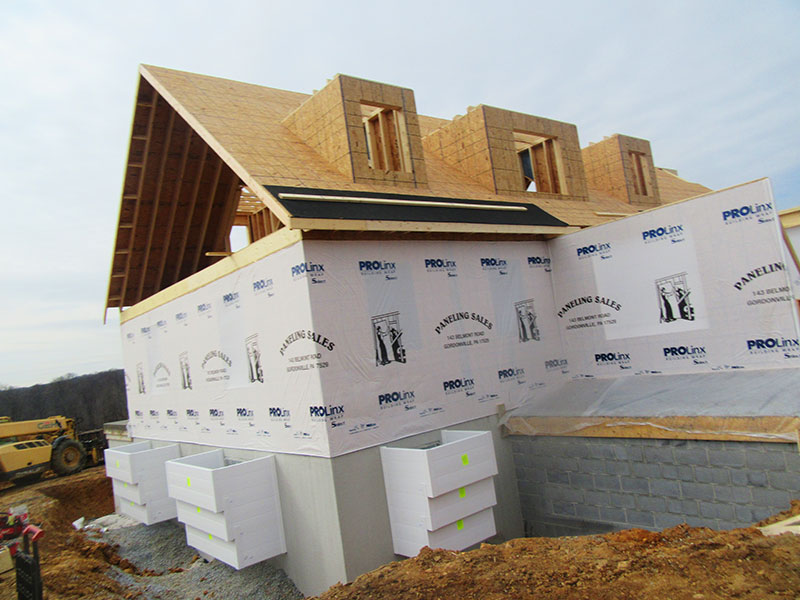 Vinyl Window Wells New Construction Site