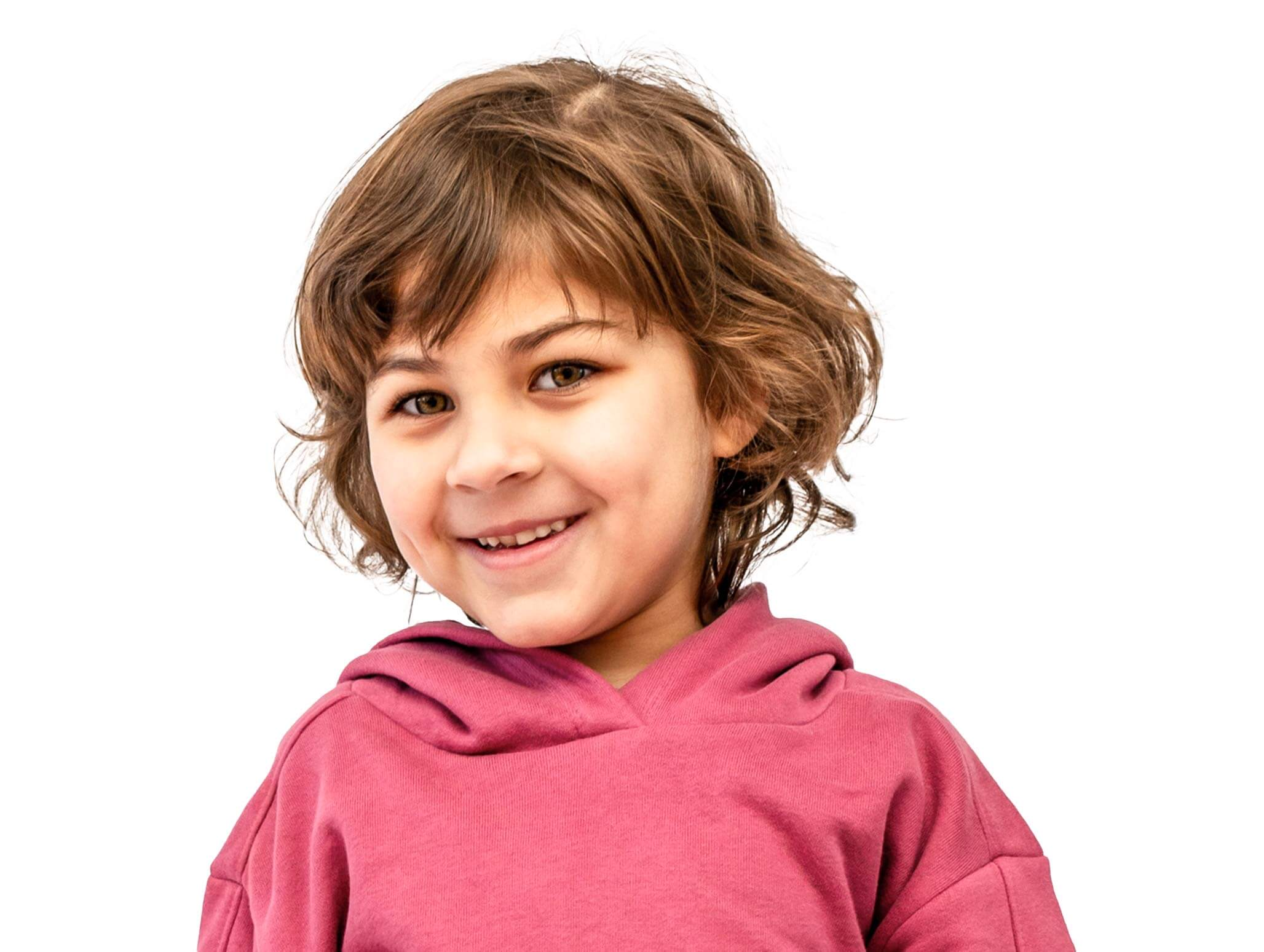 preschool aged girl with autism looking at camera smiling slightly