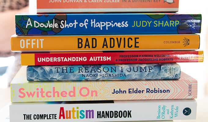 Stack of books on autism