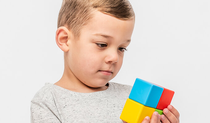 Small boy with autism playing with blocks