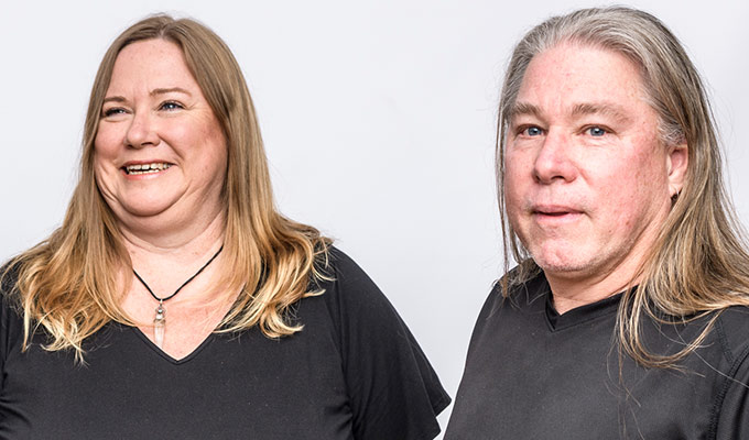 Middle aged couple with autism one looking at camera, one not