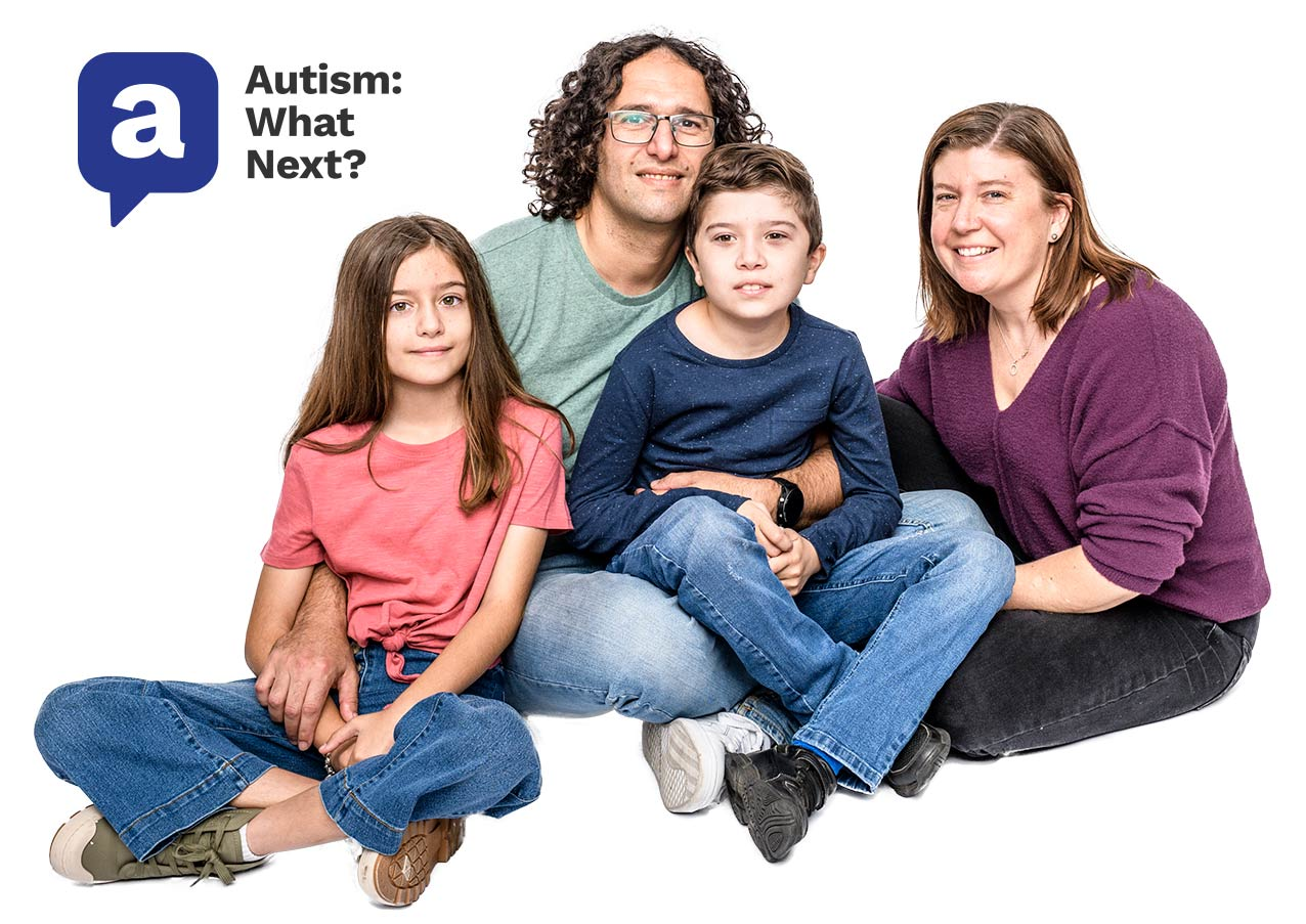 family sitting on the floor, mum, dad, some with autism and daughter