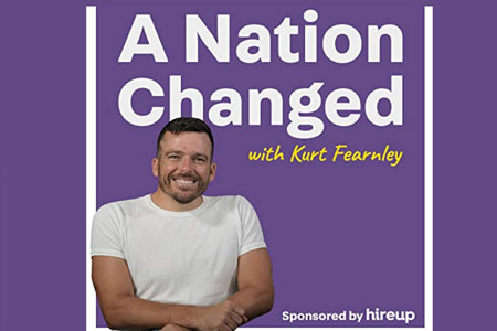 Kurt Fernley sitting in front of a nation changed podcast logo