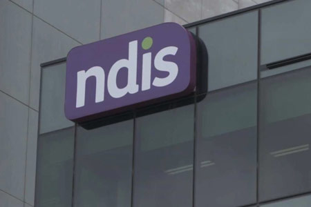 NDIS logo on side of building