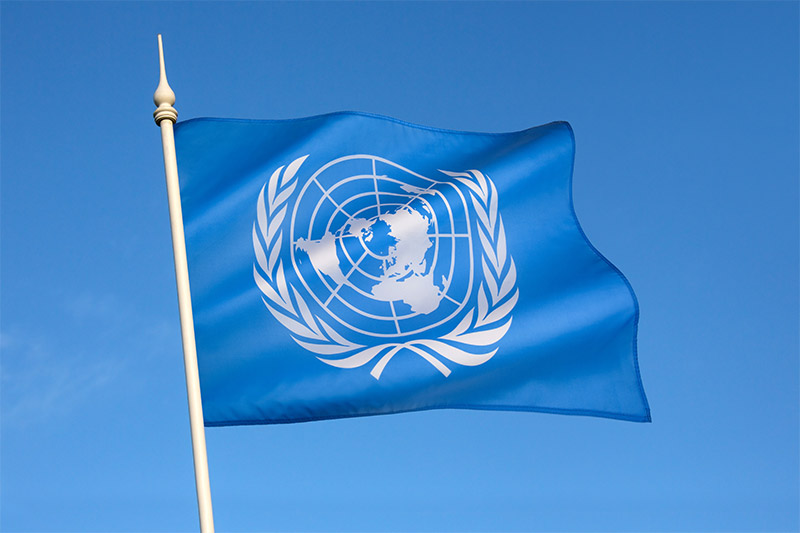 UN flag on blue sky background