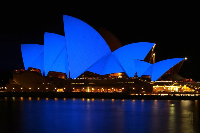 sydney harbour bridge at night lit up in blue for world autism day