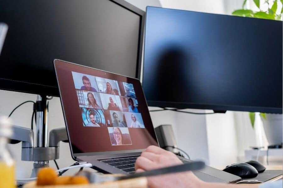 Laptop screen with ten people on zoom call