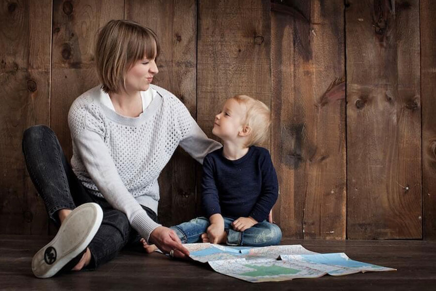 Toddler with mum reading a book