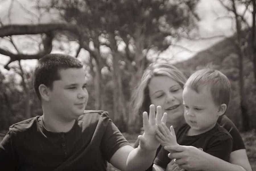 Two boys with autism and their mum