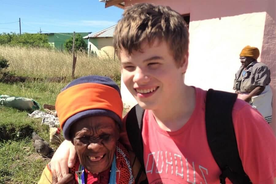 Sam best with an African elder in africa
