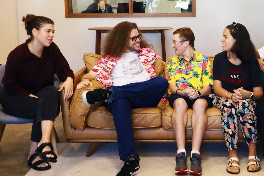 autistic adults socialising on a lounge