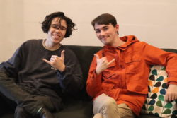 two young autistic adults sitting together