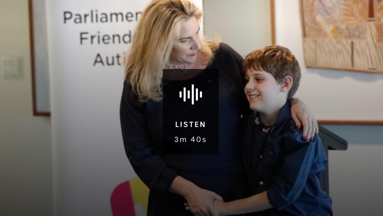 Mother hugs autistic son