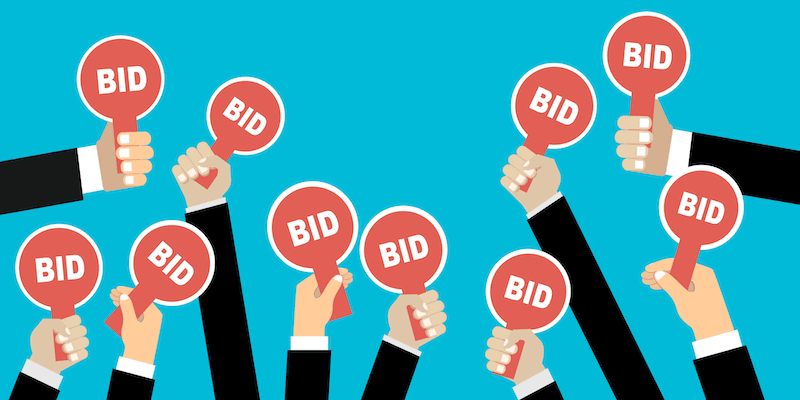Image showing cartoon hands bidding on a properrty auction.