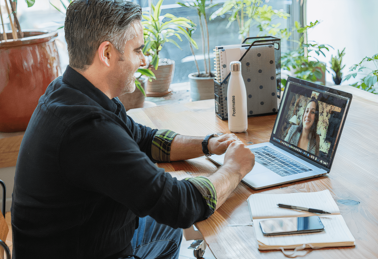 An image of a man looking at his computer screen