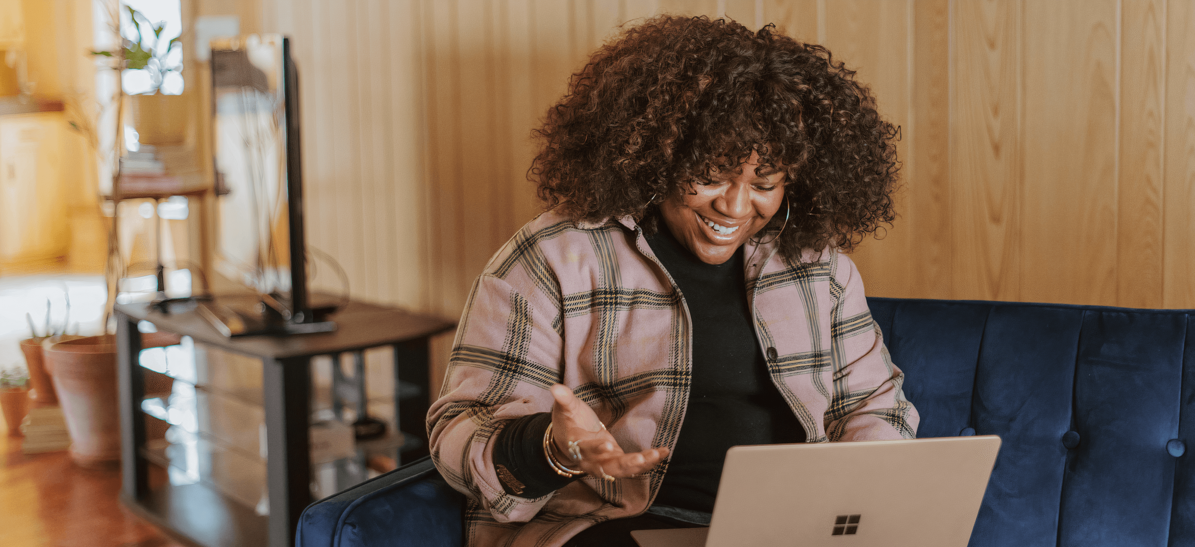 An image of a well dressed woman who appears to be explaining something to a client over a video call on her laptop