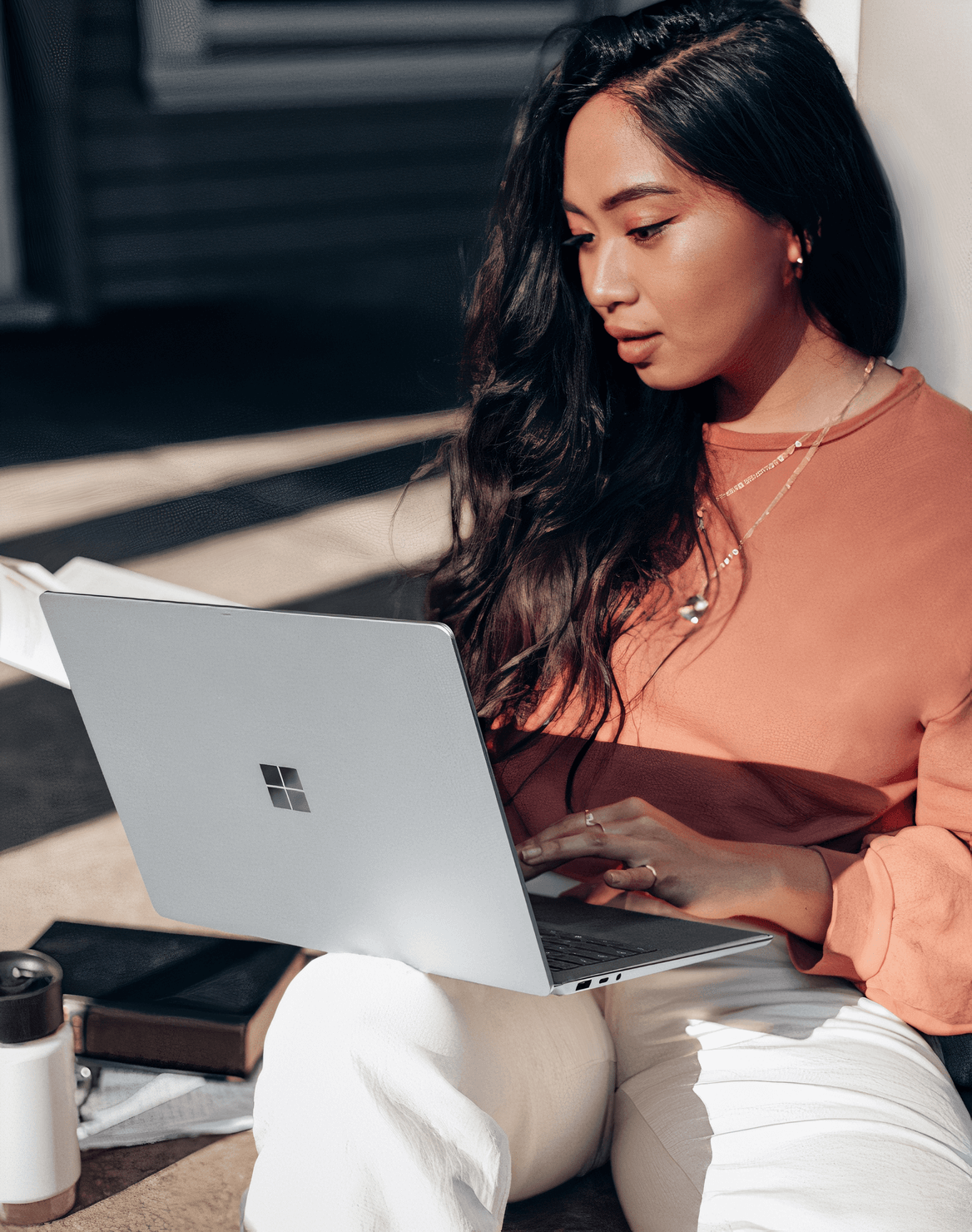 An image of a girl looking at her laptop