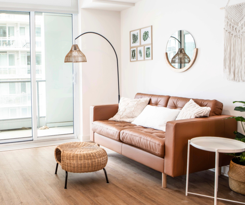Image of a living room with a brown leather couch in it