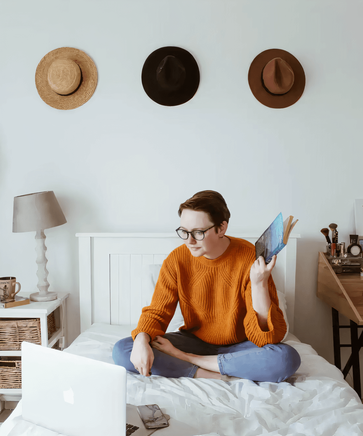 Image of a girl sitting on a bed, looking like she is making a decision