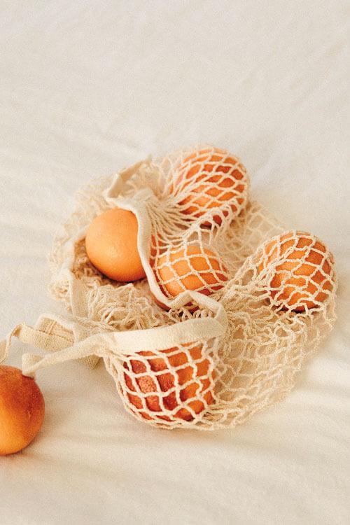 orangen in nachhaltiger Tasche