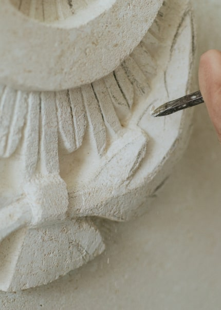 Carving on a stone by a chisel.