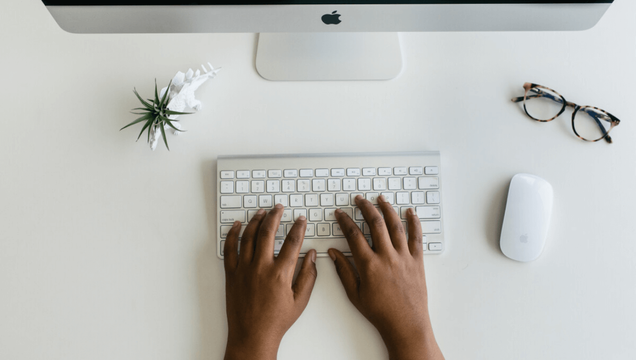 Hand typing on a keyboard
