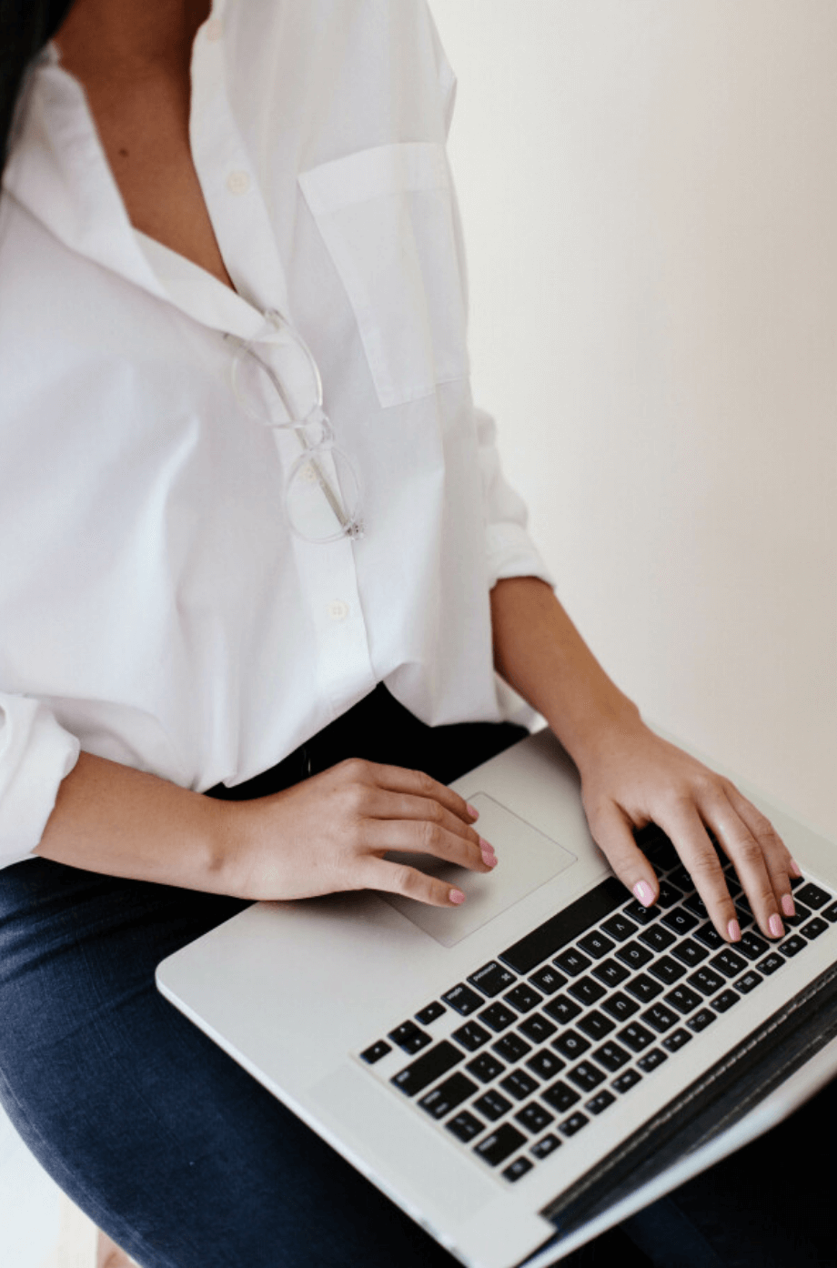 Woman with computer on her lap