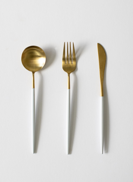 White and gold cutlery