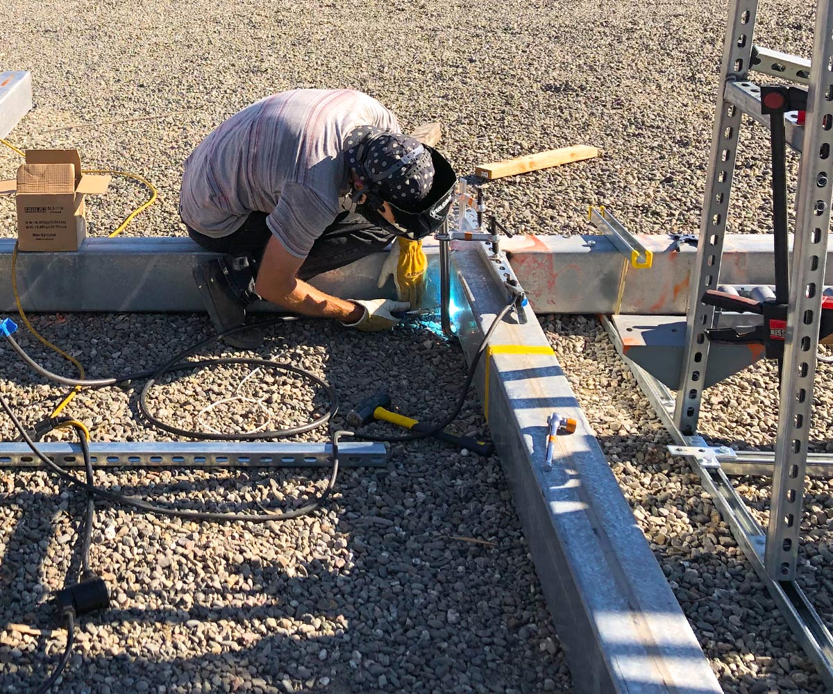 Terabase team member welding at research and development facility