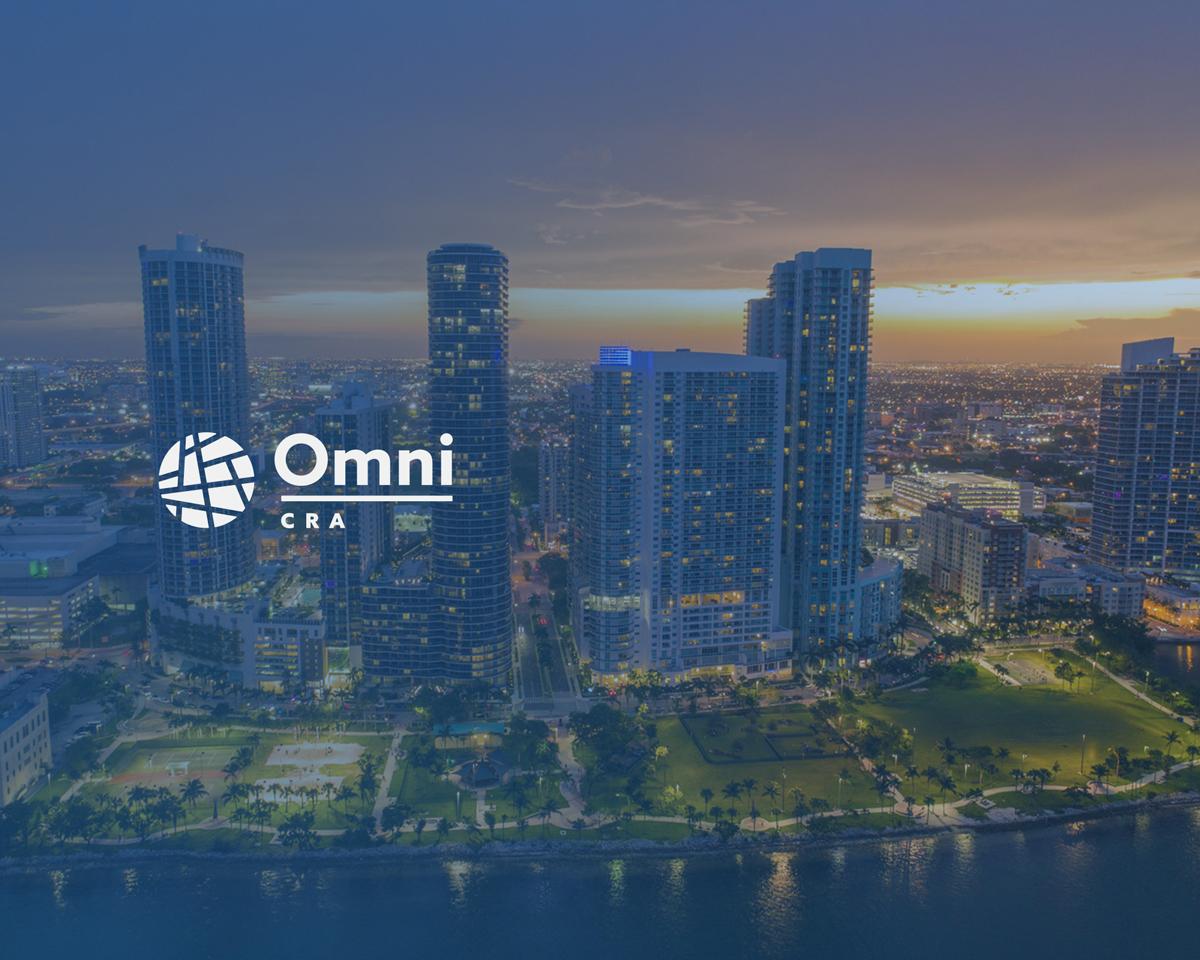 Omni CRA logo in white over skyline