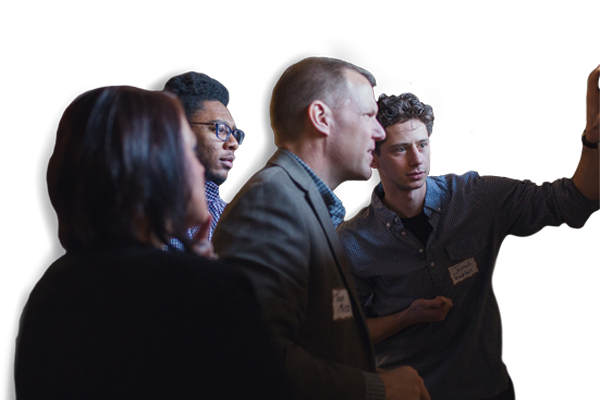 Group of entrepreneurs working together at a GreaterMSP event