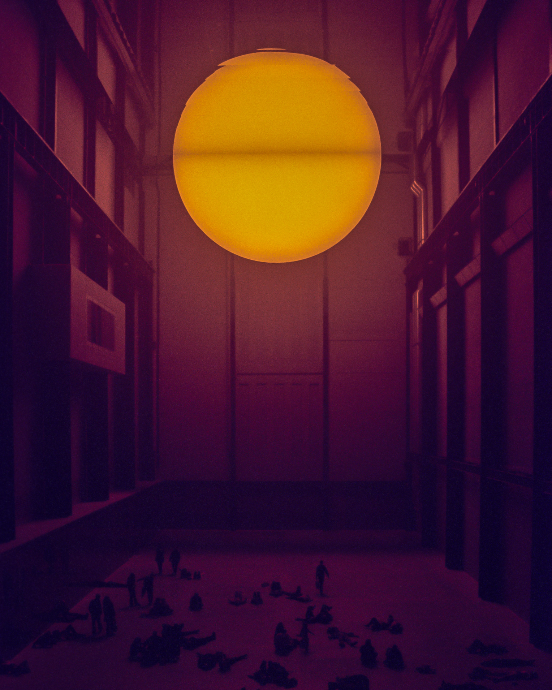 A synthetic sun shining on a crowd in the Tate Modern museum in London, England