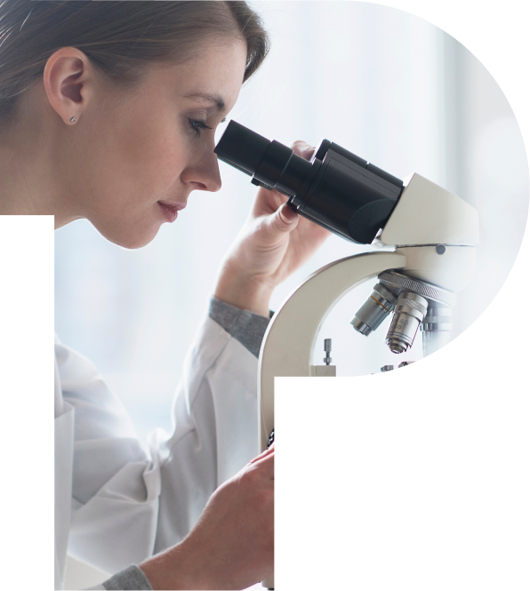 female scientist looking in magnifying glass