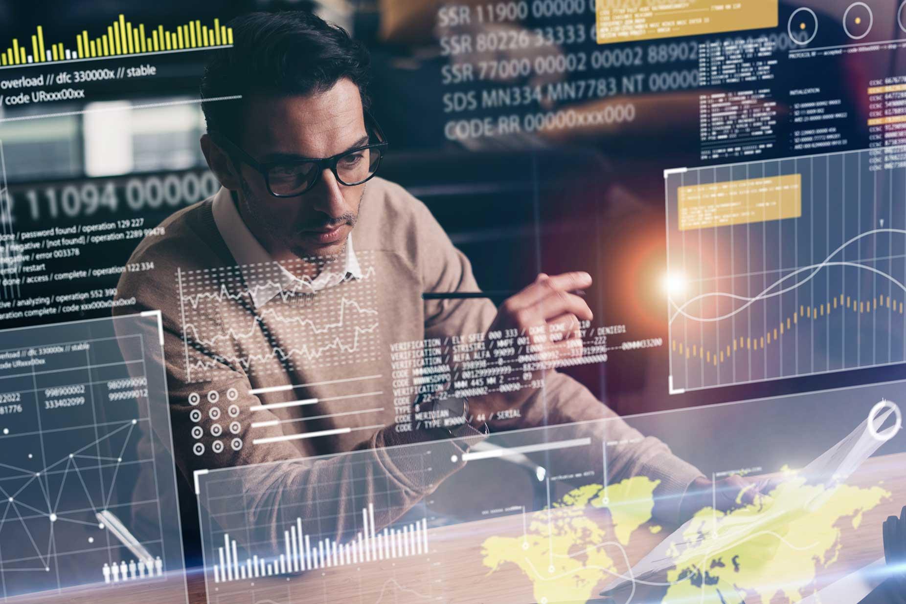 Man analyzing data from high tech monitor