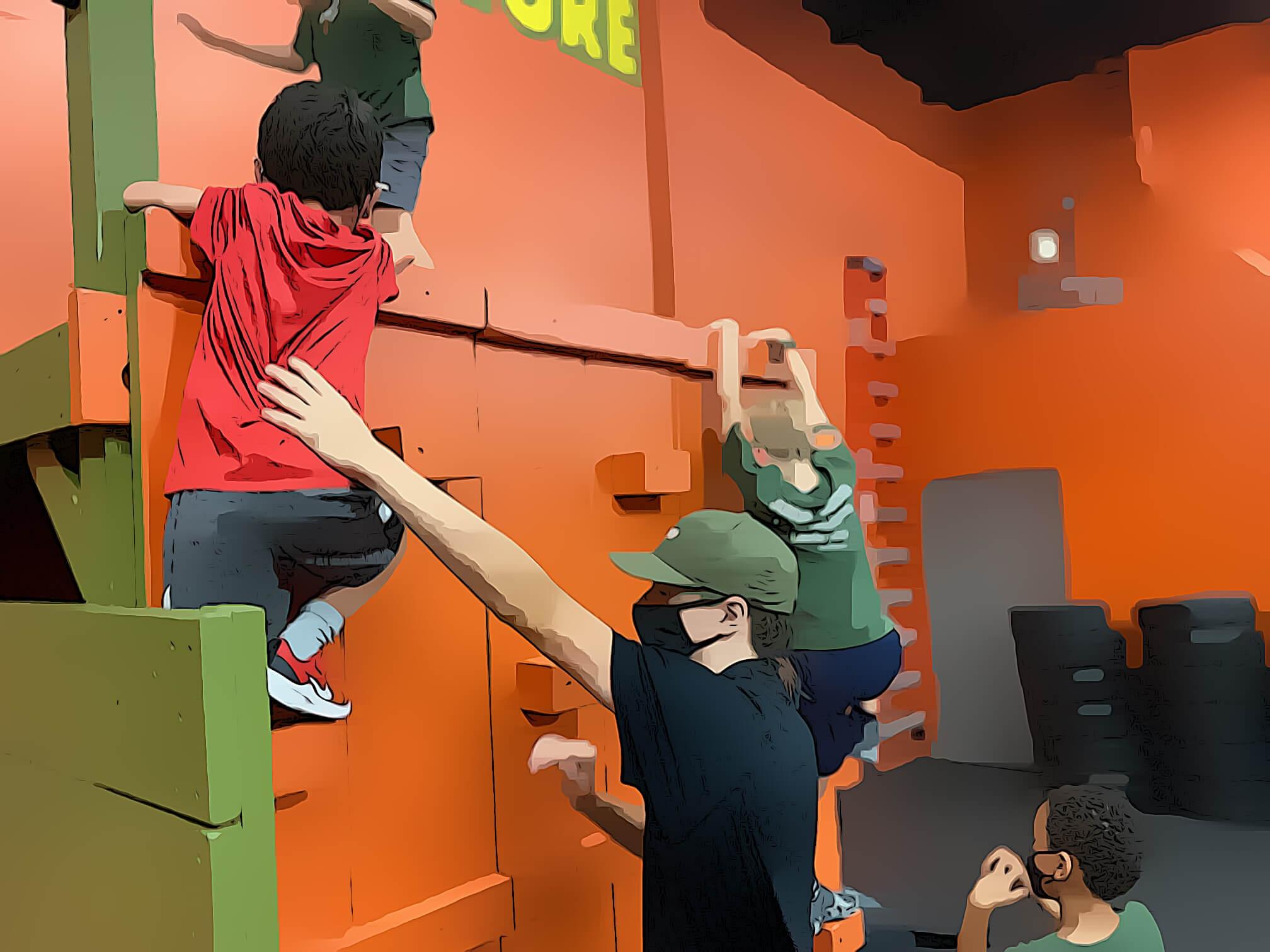 children climb over the wall