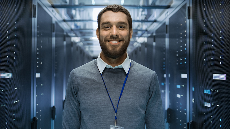 Smiling man in the server room