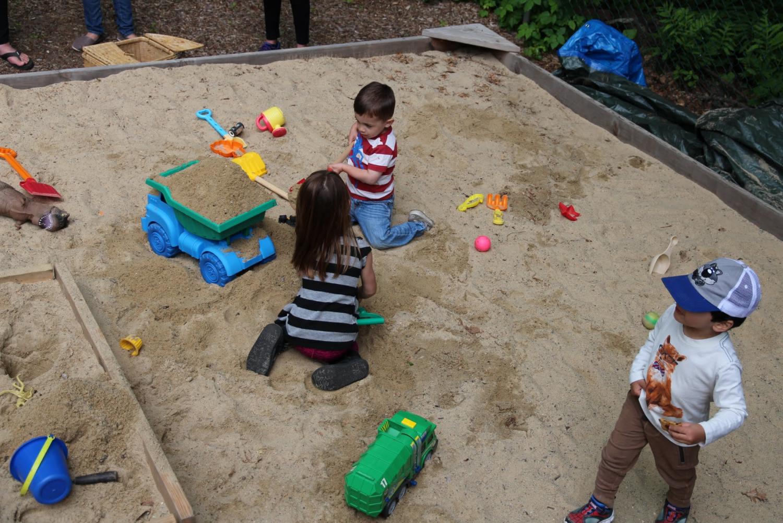 Children playing in the natural playground at StoryHeights Montessori Norfolk Location.