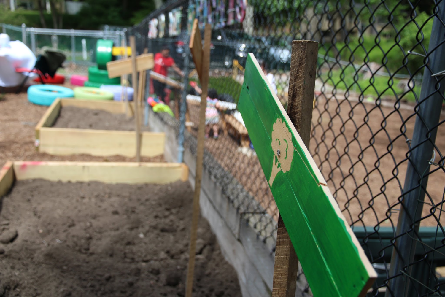 The garden section of the natural playground at StoryHeights Montessori Norfolk Location.