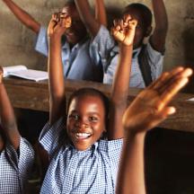 Haitian schoolchildren cheering in classroom