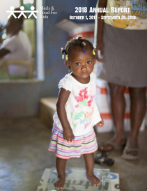Cover photo for 2018 annual report with young girl at clinic