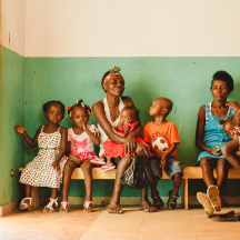 Group of a mother and several children at a malnutrition clinic