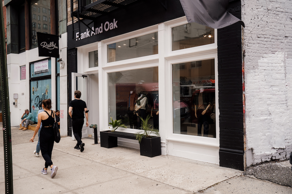 Frank And Oak Soho powered by Leap exterior with pedestrians passing by