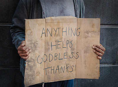 Homeless Person Holding a Sign