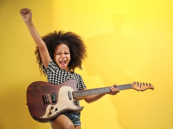 Happy girl playing guitar