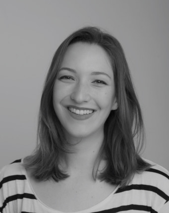 The author of the website, Miriam, a dark haired white woman, is shown in a black and white portrait. She is wearing a striped shirt and laughing vividly at the camera.
