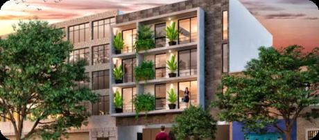 Foto de un edificio moderno de 4 pisos aproximadamente, con amplios balcones y ventanales. Ubicado en Alamos.