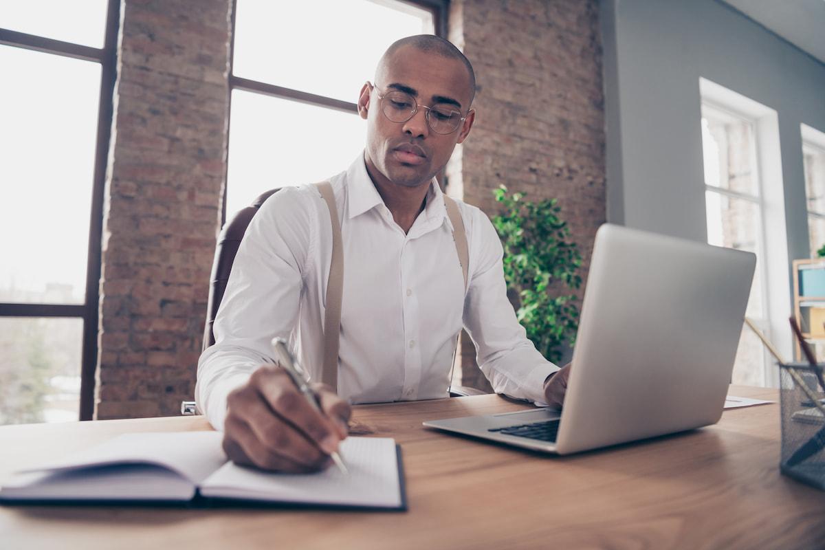 African American businessman writing