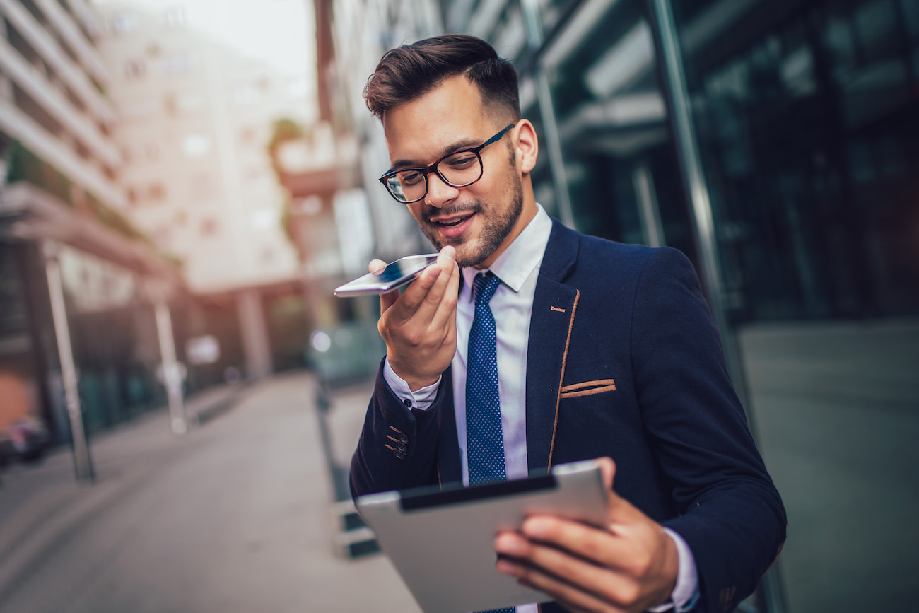 Businessman talking into phone with a tablet