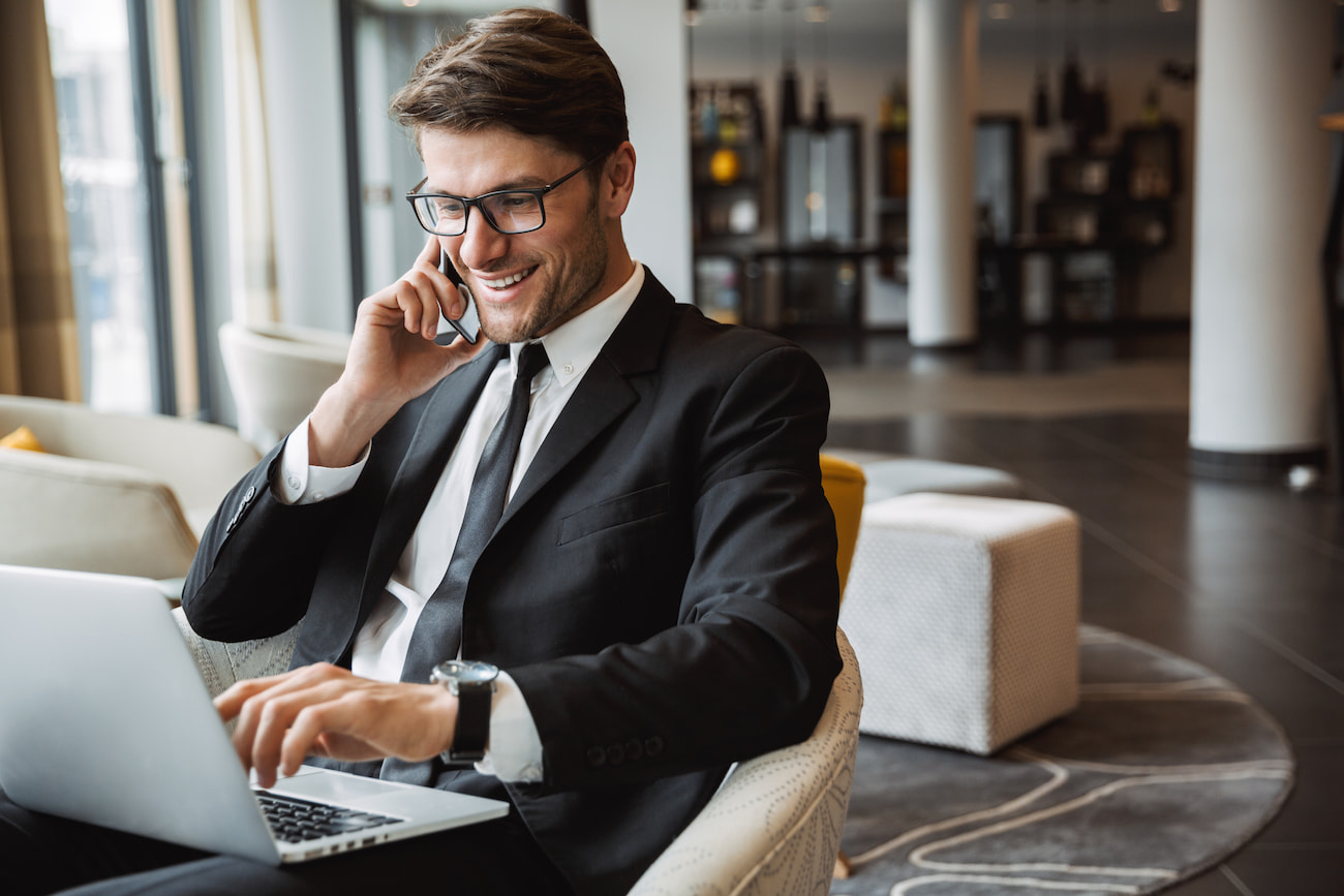 Businessman on phone with a computer