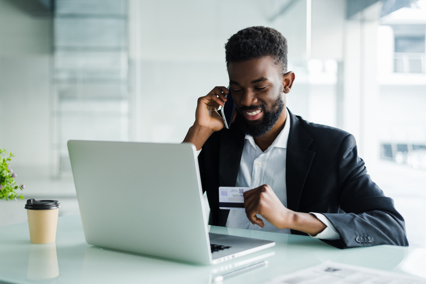 African American businessman on phone with credit card